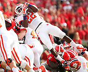 Clemson Tigers running back D.J. Howard (22) leaps into the end zone for a touchdown during Saturday's college football game against the Georgia Bulldogs at Sanford Stadium in Athens. (Staff Photo: David Welker)