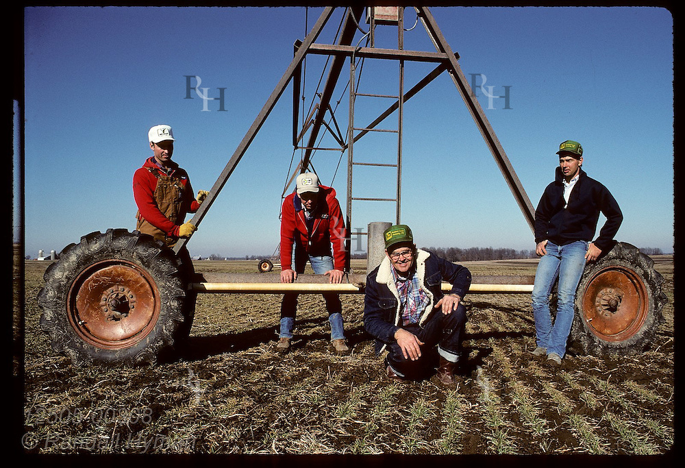 Anthony Becker poses with sons Tom, John & Bill by center-pivot irrigator on their Laddonia farm Missouri