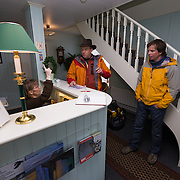 Checking into a local guest house the night before departure.<br /> <br /> Images from an ski touring adventure to Jökulfirðir, a series of fjords in west Iceland, with Bergmenn Mountain Guides and Borea Adventures. The tour takes skiers from fjord to fjord with the sail boat Aurora as a overnight base.