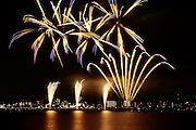 Kuwana City, Mie, Japan. Fireworks over water, a part of the city's summer festival