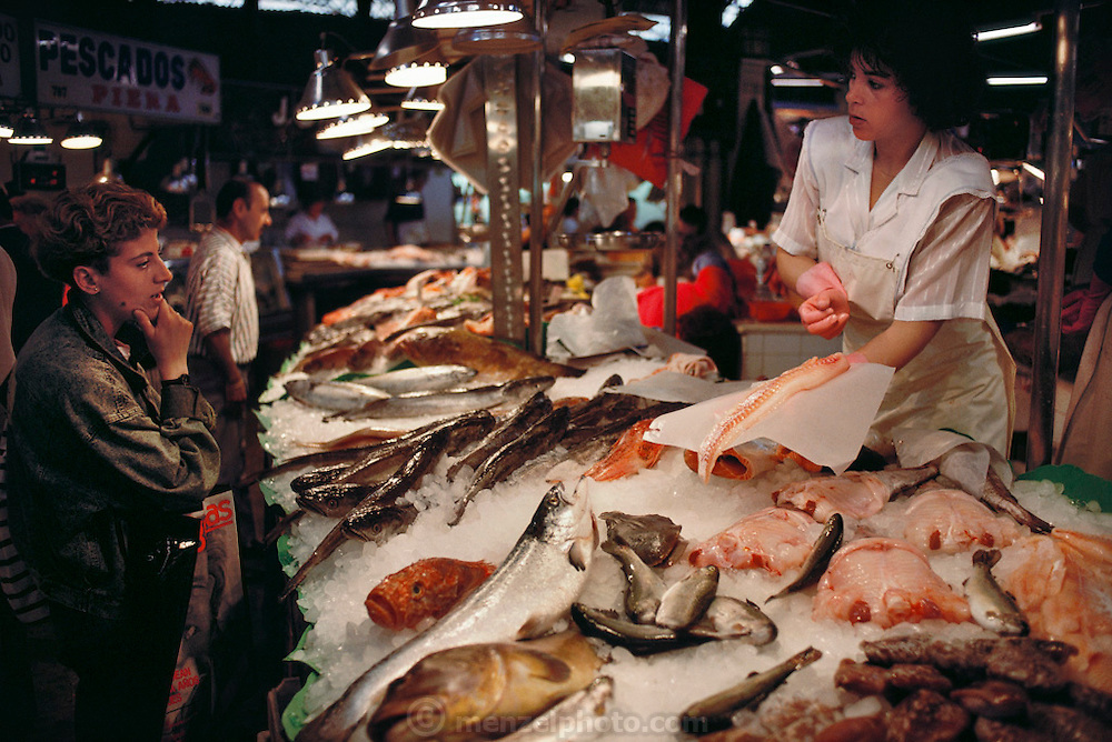 Fish vendor in the Mercado del Ninot, Barcelona, Spain.