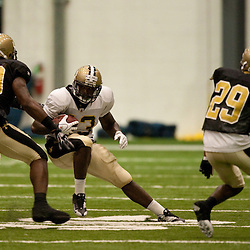 08 August 2009: Defenders Jo-Lonn Dunbar (56), Marvin Mitchell (50) and Jason David (29) close in on rookie running back P.J. Hill (43) during the New Orleans Saints annual training camp Black and Gold scrimmage held at the team's indoor practice facility in Metairie, Louisiana.