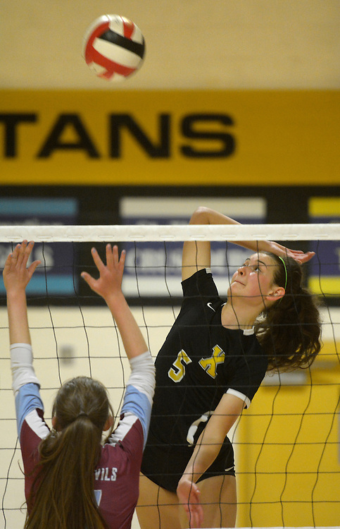 gbs091316h/SPORTS -- St. Pius' Nicole Peery, 5, goes high for a kill during the game with Sandia Prep at Pius on Tuesday, September 13, 2016. (Greg Sorber/Albuquerque Journal)
