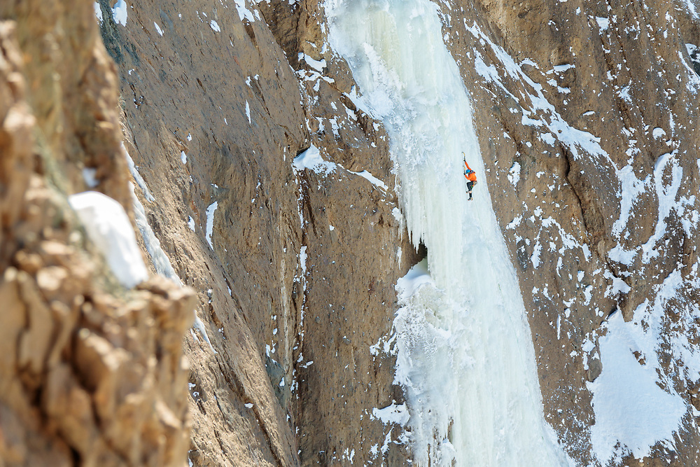 Aaron Mulkey climbing Joy After Pain in Cody, Wyoming