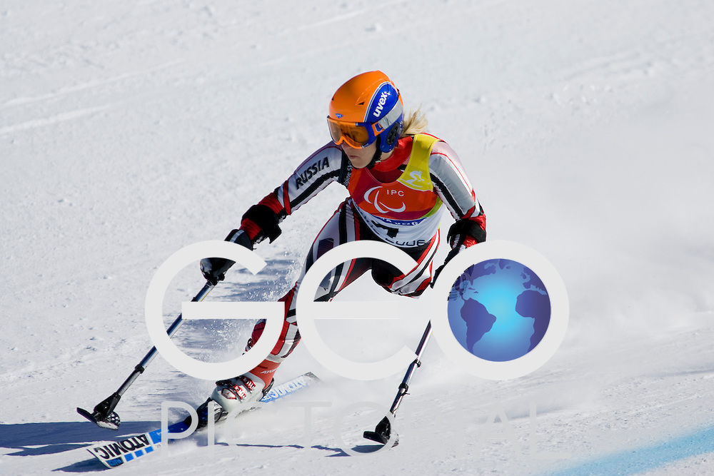 SESTRIERE COLLE, ITALY - MARCH  13th : Oxana Miryasova (LW2) of Russia in the Womens Alpine Skiing Super G competition, finishing in 13th place, on Day 3 of the 2006 Turin Winter Paralympic Games on March 13th, 2006 in Sestriere Borgata, Italy.