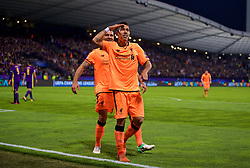 MARIBOR, SLOVENIA - Tuesday, October 17, 2017: Liverpool's Roberto Firmino celebrates scoring the fifth goal during the UEFA Champions League Group E match between NK Maribor and Liverpool at the Stadion Ljudski vrt. (Pic by David Rawcliffe/Propaganda)