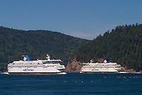 Active Pass between Mayne and Galiano Island is a busy thoroughfare for vessels transiting the Gulf Islands including these two BC Ferries vessels.  Gulf Islands, British Columbia, Canada.