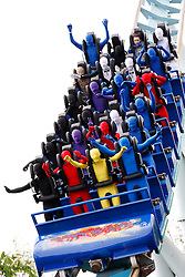 "© licensed to London News Pictures. Tamworth/Staffordshire, UK  07/05/2011. Morphsuit challenge to break the Guiness World Record at Drayton Manor Park, Tamworth, Staffs. Pictured, Morphs take a ride on the ""Shock Wave"" ride. Please see special instructions for usage rates. Photo credit should read Dave Warren/LNP"