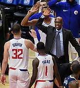 Clipper assistant coach Sam Cassell congratulates players at the end of the game. The Los Angeles Clippers defeated the  Denver Nuggets 109-104 at Staples Center in Los Angeles, CA 1/017/2018 (Photo by John McCoy, Los Angeles Daily News/SCNG)