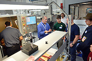 WARMINSTER, PA -  OCTOBER 4: Kevin Danielson (center) speaks to students from Upper Moreland High School at MK Precision October 4, 2013 in Warminster, Pennsylvania.  Warminster's MK Precision participated in National Manufacturing Day, a nationwide event in which local manufacturers host open houses at their facilities to raise awareness that American manufacturing is far from dead. (Photo by William Thomas Cain/Cain Images)
