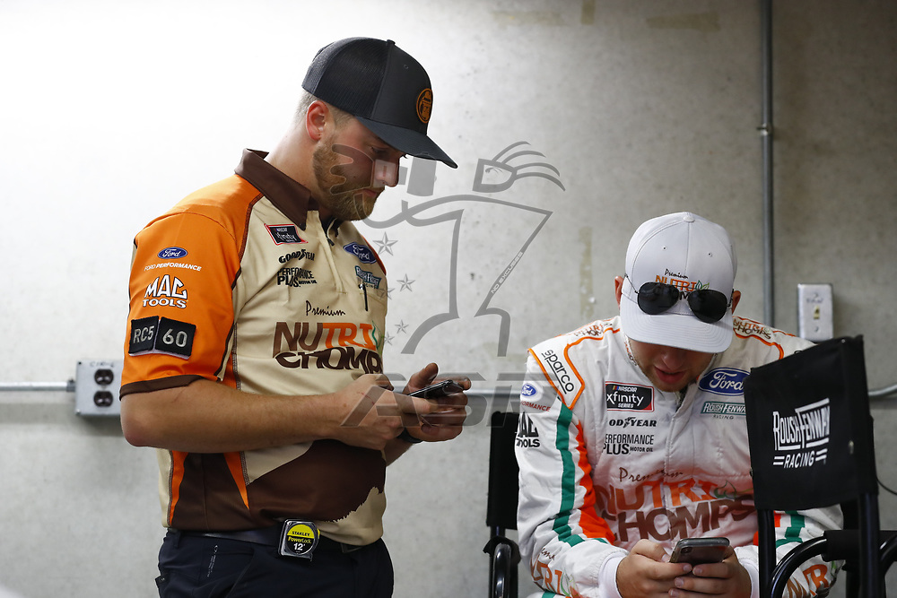 Chase Briscoe (60) hangs out in the garage area during a rain delay for practice for the Lilly Diabetes 250 at Indianapolis Motor Speedway in Indianapolis, Indiana.