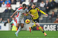 Freddie Sears of Colchester United looks to get past Lee Hodson of MK Dons during the Sky Bet League 1 match between Milton Keynes Dons and Colchester United at stadium:mk, Milton Keynes<br /> Picture by Richard Blaxall/Focus Images Ltd +44 7853 364624<br /> 29/11/2014