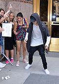 Justin Biber picks a a cellphone that was dropped by a fan