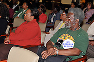 MAY 9, 2011 - MINEOLA, NY: At  right, Joe Louis Brown wearing large WE DESERVE BETTER button on shirt, at Nassau County Legislature's public hearing on Legislative Redistricting. Mr. Bown is a member of NYCC, the New York Communities for Change. At Nassau County Executive and Legislative Building, 1550 Franklin Avenue, Mineola, New York, USA on May 9, 2011.