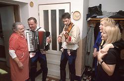 CZECH REPUBLIC MORAVIA BANOV APR98 - Jiri Chovanec and his son Jan perform for a family gathered in a hallway during the traditional Easter celebrations. <br /> <br /> &copy; Jiri Rezac 1998<br /> <br /> Tel:   +44 (0) 7050 110 417<br /> Email: info@jirirezac.com<br /> Web:   www.jirirezac.com