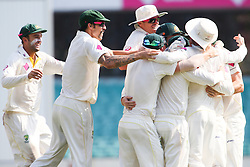 © Licensed to London News Pictures. 05/01/2014. Australian team jump on each other in celebration after winning the Ashes during day 3 of the 5th Ashes Test Match between Australia Vs England at the SCG on 5 January, 2013 in Melbourne, Australia. Photo credit : Asanka Brendon Ratnayake/LNP