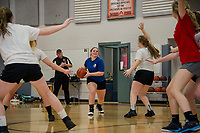 Isabella McDonald works on practice drills with her teammates Tuesday afternoon as coach Mark Dewalga watches from the sidelines at Belmont High School.  (Karen Bobotas/for the Laconia Daily Sun)