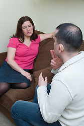 Man with a hearing talking to his sister using sign language,