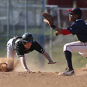 Edwin Owolo, McMahon Senators, tags out a runner at second base during the High School Baseball ball game between Trumbull Golden Eagles and McMahon Senators at Brien McMahon High School. Norwalk, Connecticut. USA. 26th April 2012. Photo Tim Clayton
