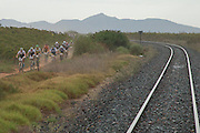 The lead bunch follow a  railway track during stage 1 of the 2014 Absa Cape Epic Mountain Bike stage race held from Arabella Wines in Robertson, South Africa on the 24 March 2014<br /> <br /> Photo by Greg Beadle/Cape Epic/SPORTZPICS
