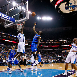 November 17, 2010; New Orleans, LA, USA; Dallas Mavericks shooting guard DeShawn Stevenson (92) shoots over New Orleans Hornets center Emeka Okafor (50) during the first quarter at the New Orleans Arena. Mandatory Credit: Derick E. Hingle