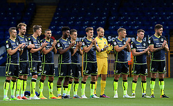 Bristol Rovers players take part in a minutes applause in memory of the Barcelona terror attack victims - Mandatory by-line: Matt McNulty/JMP - 19/08/2017 - FOOTBALL - Gigg Lane - Bury, England - Bury v Bristol Rovers - Sky Bet League One
