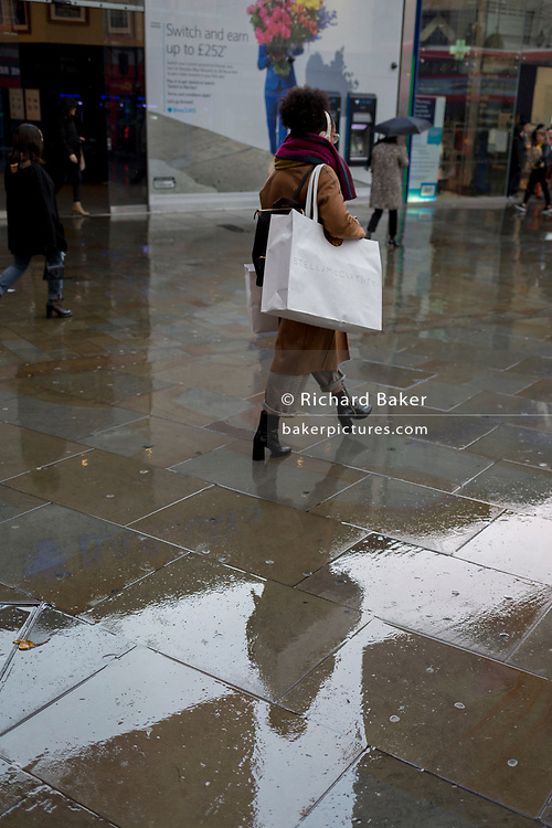 Londoners make their way through a rainy Piccadilly Circus in the West End, on 12th November 2019, in London, England.