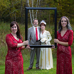 October wedding in Finlayson, Minnesota. Bride wore a classic wedding dress from 1945. Wedding party wore red accents. Country theme.