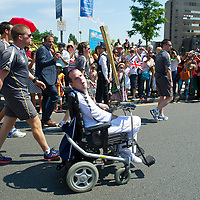 25.07.2012 - © Blake-Ezra Photography Ltd..Simon Davies, a volunteer for Jewish Care, who has Cerebral Palsy, is cheered on as he carries the Olympic torch through Barnet on Wednesday July 25th 2012. .Credit: Blake Ezra Photography / www.blakeezraphotography.com .Not for commercial or 3rd party use.