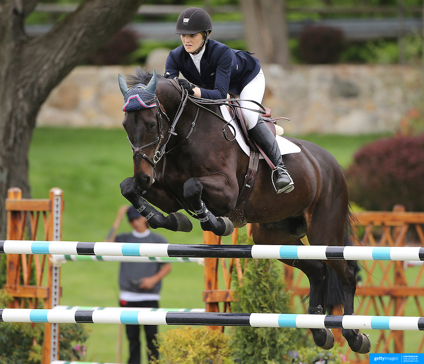 NORTH SALEM, NEW YORK - May 21: Katherine Strauss riding All In in action during The $15,000 Under 25 T & R Development Grand Prix at the Old Salem Farm Spring Horse Show on May 21, 2016 in North Salem, New York. (Photo by Tim Clayton/Corbis via Getty Images)
