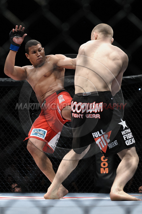 "DUBLIN, IRELAND, JANUARY 17, 2009: Alexandre Barros (facing) kicks Martin Kampmann during ""UFC 93: Franklin vs. Henderson"" inside the O2 Arena in Dublin, Ireland"