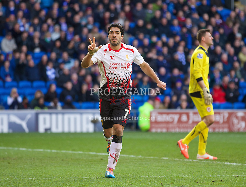 CARDIFF, WALES - Saturday, March 22, 2014: Liverpool's Luis Suarez celebrates scoring the sixth goal, the third of his hat-trick, against Cardiff City during the Premiership match at the Cardiff City Stadium. (Pic by David Rawcliffe/Propaganda)