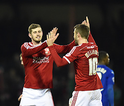 Swindon's Jack Stephens and Andy Williams celebrate their team's win over Chesterfield in the Sky Bet League One match between Swindon Town and Chesterfield at The County Ground on January 17, 2015 in Swindon, England.- Photo mandatory by-line: Paul Knight/JMP - Mobile: 07966 386802 - 17/01/2015 - SPORT - Football - Swindon - The County Ground - Swindon Town v Chesterfield - Sky Bet League One