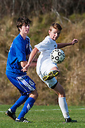 CVU's Nate Coffin (14) battles for the ball with Mt. Anthony's Matthew Anderson (17) during the boys semifinal soccer game between Mount Anthony and Champlain Valley Union at CVU high school on Tuesday afternoon October 27, 2015 in Hinesburg. (BRIAN JENKINS/ for the FREE PRESS)