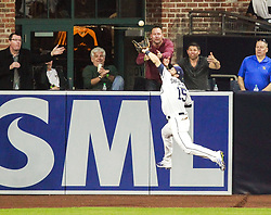 May 2, 2017 - San Diego, CA, USA - The San Diego Padres' Cory Spangenberg catches a hit deep into left field by the Colorado Rockies' Gerardo Parra for an out in the second inning at Petco Park in San Diego on Tuesday, May 2, 2017. (Credit Image: © Hayne Palmour Iv/TNS via ZUMA Wire)