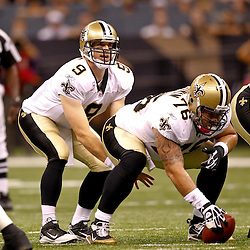 Oct 24, 2010; New Orleans, LA, USA; New Orleans Saints quarterback Drew Brees (9) under center during a game against the Cleveland Browns at the Louisiana Superdome. The Browns defeated the Saints 30-17.  Mandatory Credit: Derick E. Hingle