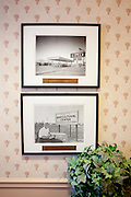 Old photos hang on a wall inside the Heritage Palmeras, a luxurious apartment complex for the older residents in Sun City, Arizona August 2010. .2010 marks the 50th anniversary of the United States' first planned retirement city. When Del Webb created Sun City and it opened in 1960, it was a revolutionary idea for retirees to move away from home and to live extremely active and social lifestyles..