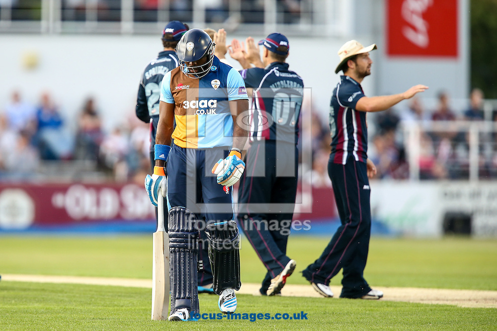 Chesney Hughes of Derbyshire Falcons (left) trudges off after being dismissed during the Natwest T20 Blast match at the County Ground, Northampton<br /> Picture by Andy Kearns/Focus Images Ltd 0781 864 4264<br /> 11/07/2014