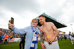 Matt Taylor celebrates with a fan after Bristol Rovers win the match in injury time to secure 3rd place in League 2, back to back promotions and a place in Sky Bet League 1 for 2016/17 - Mandatory byline: Rogan Thomson/JMP - 08/03/2016 - FOOTBALL - Memorial Stadium - Bristol, England - Bristol Rovers v Dagenham & Redbridge - Sky Bet League 2.