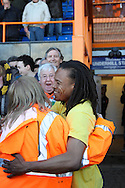 Picture by David Horn/Focus Images Ltd +44 7545 970036.20/04/2013.Edgar Davids , player/manager hugs a saftety steward after the npower League 2 match at Underhill Stadium, London.