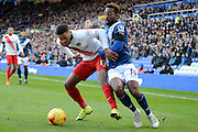 Birmingham City midfielder Jacques Maghoma and Charlton Athletic defender Tareiq Holmes-Dennis battle during the Sky Bet Championship match between Birmingham City and Charlton Athletic at St Andrews, Birmingham, England on 21 November 2015. Photo by Alan Franklin.
