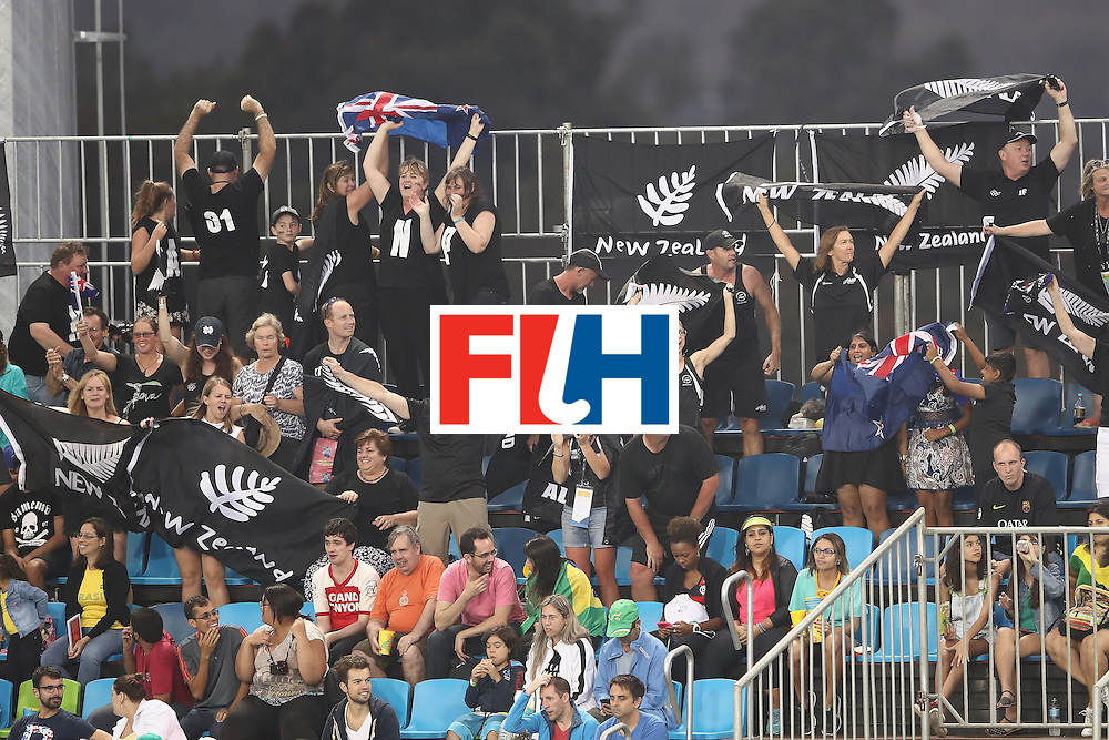 RIO DE JANEIRO, BRAZIL - AUGUST 07:   New Zealand supporters in the crowd cheer during the men's pool A match between Great Britain and New Zealand on Day 2 of the Rio 2016 Olympic Games at the Olympic Hockey Centre on August 7, 2016 in Rio de Janeiro, Brazil.  (Photo by Mark Kolbe/Getty Images)