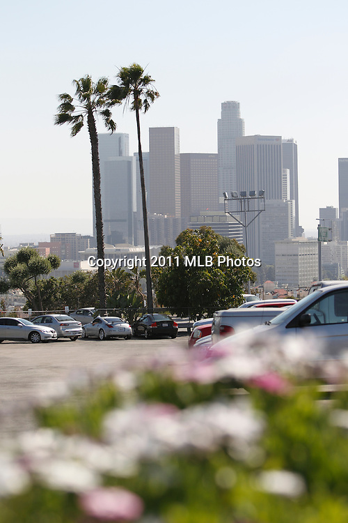 LOS ANGELES, CA - APRIL 15:  Palm trees blow in the wind as downtown LA skyscrapers loom large prior to the game between the St. Louis Cardinals and the Los Angeles Dodgers on Friday April 15, 2011 at Dodger Stadium in Los Angeles, California. (Photo by Paul Spinelli/MLB Photos via Getty Images)