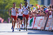 (R) Yared Shegumo from Poland competes in men's marathon during the Sixth Day of the European Athletics Championships Zurich 2014 at Letzigrund Stadium in Zurich, Switzerland.<br /> <br /> Switzerland, Zurich, August 17, 2014<br /> <br /> Picture also available in RAW (NEF) or TIFF format on special request.<br /> <br /> For editorial use only. Any commercial or promotional use requires permission.<br /> <br /> Photo by &copy; Adam Nurkiewicz / Mediasport