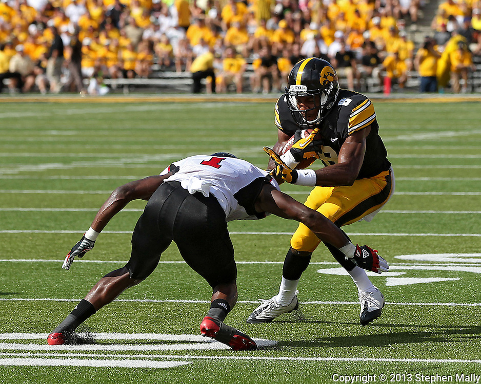 August 31 2013: Iowa Hawkeyes wide receiver Don Shumpert (8) tries to avoid Northern Illinois Huskies safety Dechane Durante (1) after a catch during the second quarter of the NCAA football game between the Northern Illinois Huskies and the Iowa Hawkeyes at Kinnick Stadium in Iowa City, Iowa on August 31, 2013. Northern Illinois defeated Iowa 30-27.
