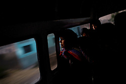 People ride a bus home after work in La Oroya, Peru.