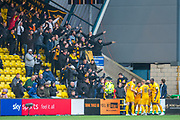 Scott Robinson (#17) of Livingston FC and his team mates celebrate in front of the Livingston fans after Robinson scores the opening goal during the Ladbrokes Scottish Premiership match between Livingston FC and Celtic FC at The Tony Macaroni Arena, Livingston, Scotland on 6 October 2019.
