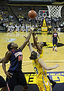 February 24 2011: Illinois Fighting Illini forward Karisma Penn (00)m Iowa Hawkeyes forward Kalli Hansen (3), and Iowa Hawkeyes guard Kachine Alexander (21) battle for a rebound during the first half of an NCAA women's college basketball game at Carver-Hawkeye Arena in Iowa City, Iowa on February 24, 2011. Iowa defeated Illinois 83-64.