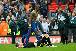 LONDON, ENGLAND - Saturday, May 17, 2008: Cardiff City's Peter Whittingham lies dejected as Portsmouth's Sylvain Distin celebrates winning during the FA Cup Final at Wembley Stadium. (Photo by Chris Ratcliffe/Propaganda)
