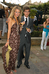 KATE MELHUISH and JACK FREUD at the Tatler Summer Party in association with Moschino at Home House, 20 Portman Square, London W1 on 29th June 2005.<br />